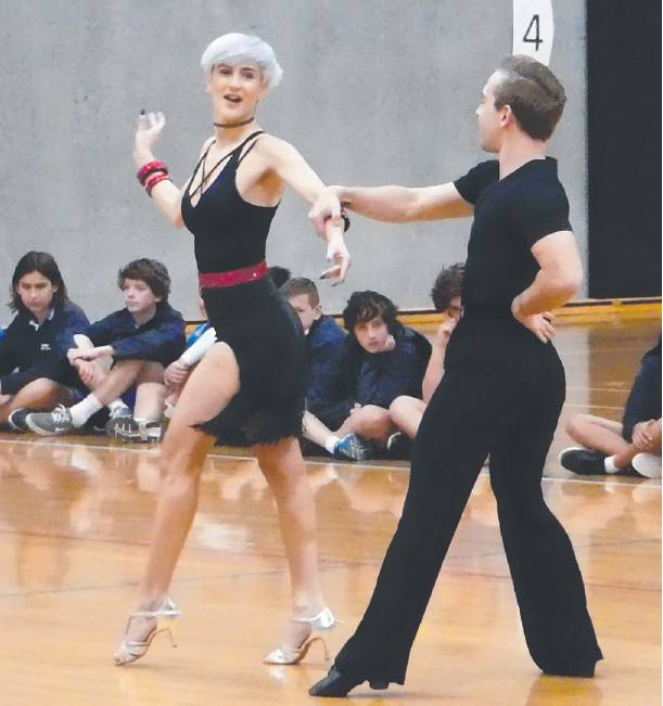 Professional dancers with Dancesport Confidence demonstrate a range of moves to students.